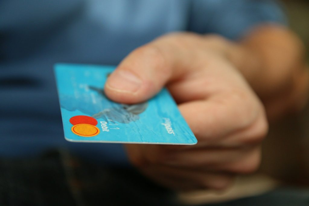 Human hand holding a credit card